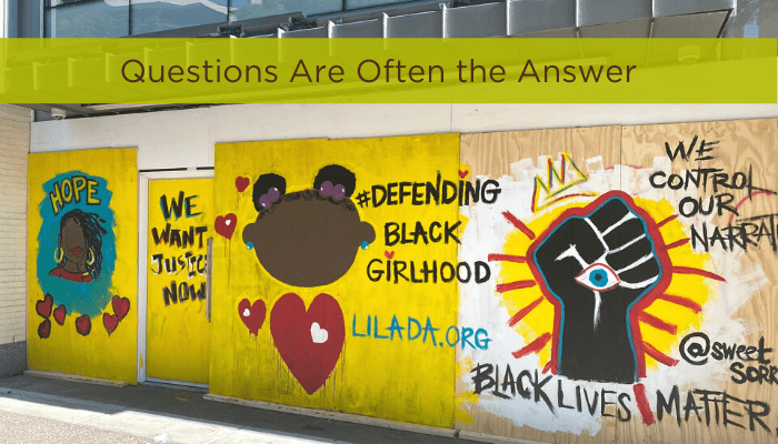 text reading questions are always the answer graffiti of black lives matter protest female focused message